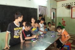 Volunteer Teaching Boys Math in Vietnam