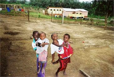 Ghana Volunteer Kaitlyn Scott Carrying Kids