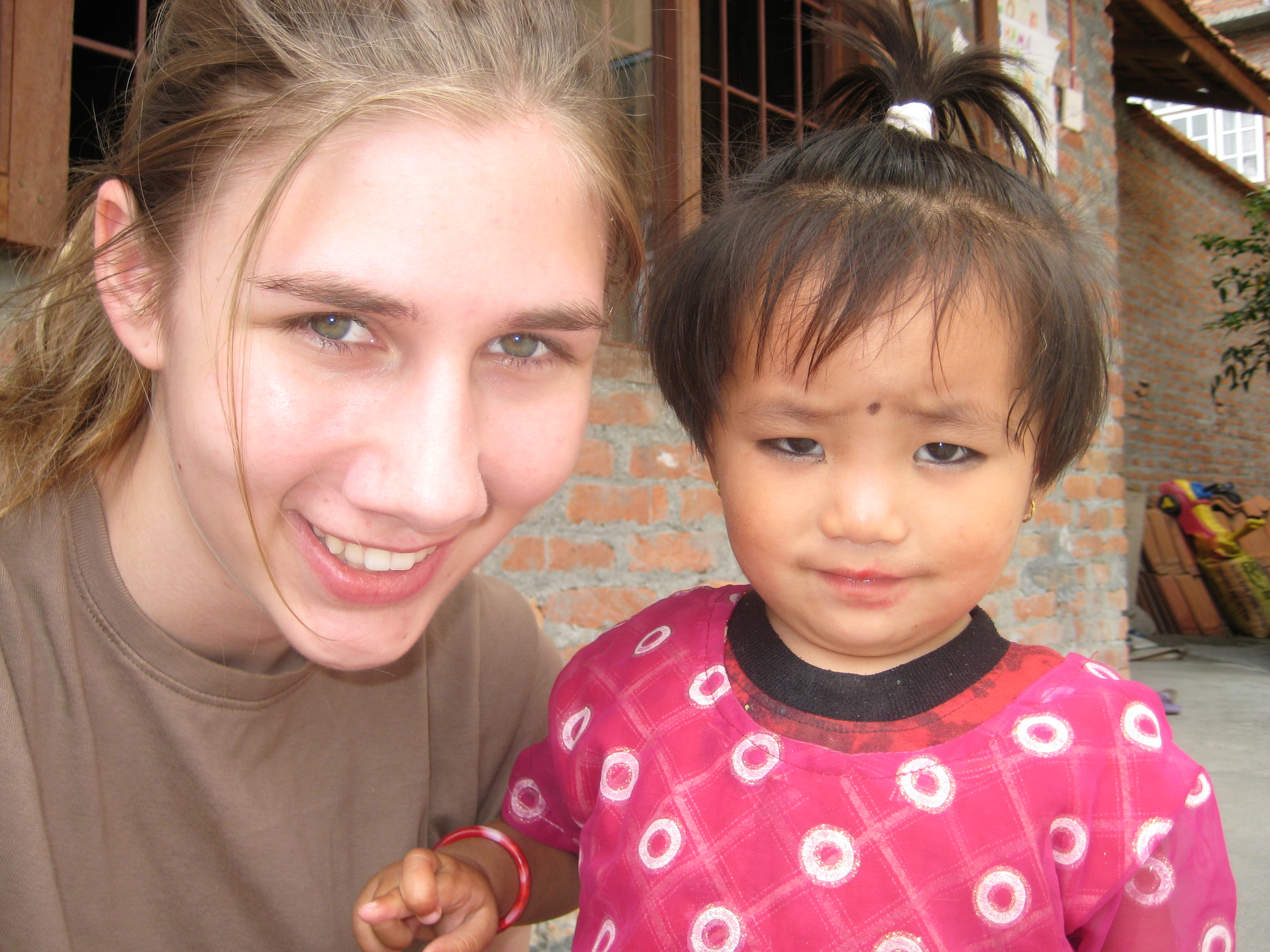 Nepal Teachers Rachel and Britanny Preschool Child